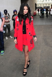 Never one to miss out on the trends, Selena hops on the 70;s inspired band wagon with a cherry red coat complete with floral applique and matching skirt. I've already been dreaming of waking up as Selena Gomez one day, but now I REALLY want to because it would mean I would own this look in my closet.