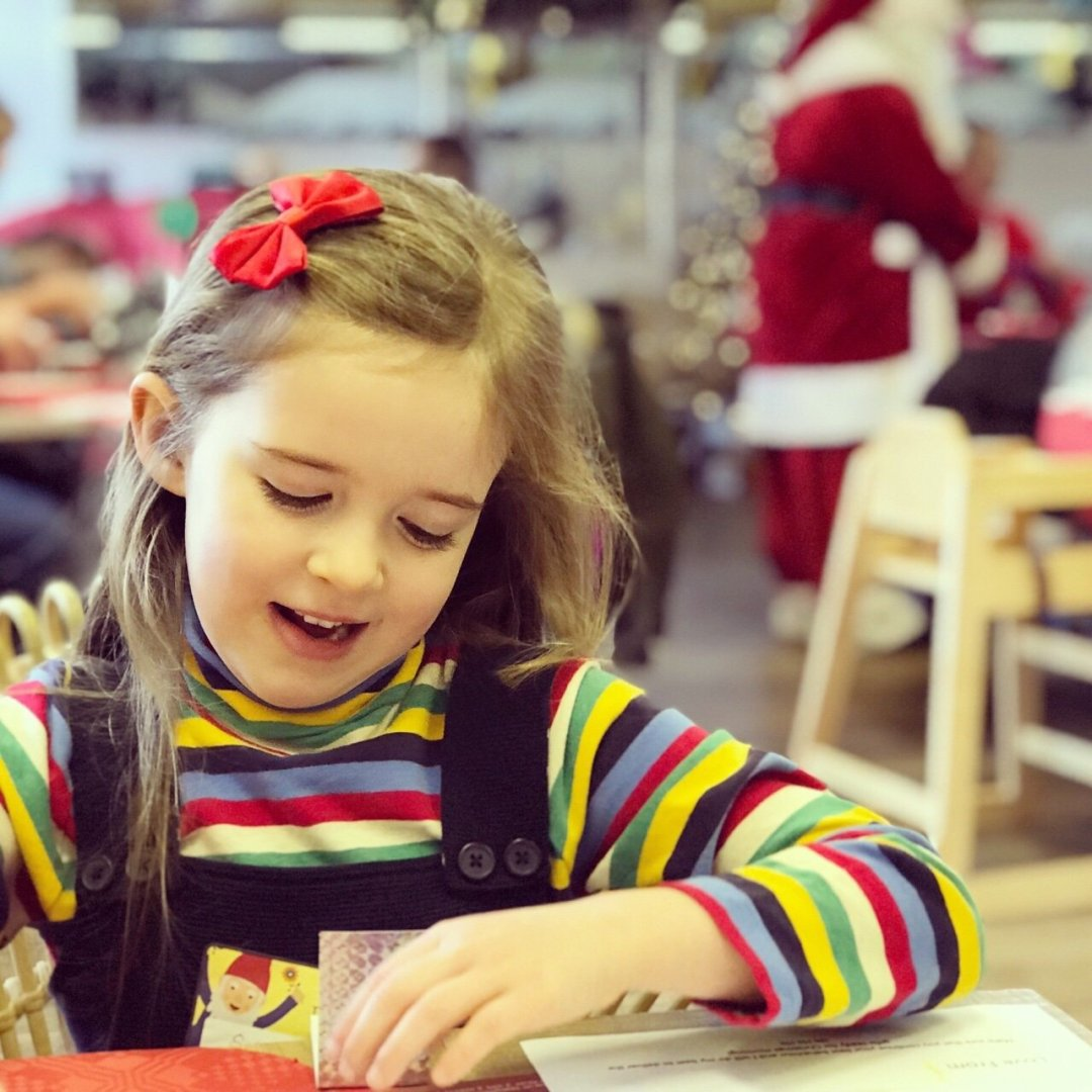 My Sunday Photo Eden colouring at the table with Santa in the background