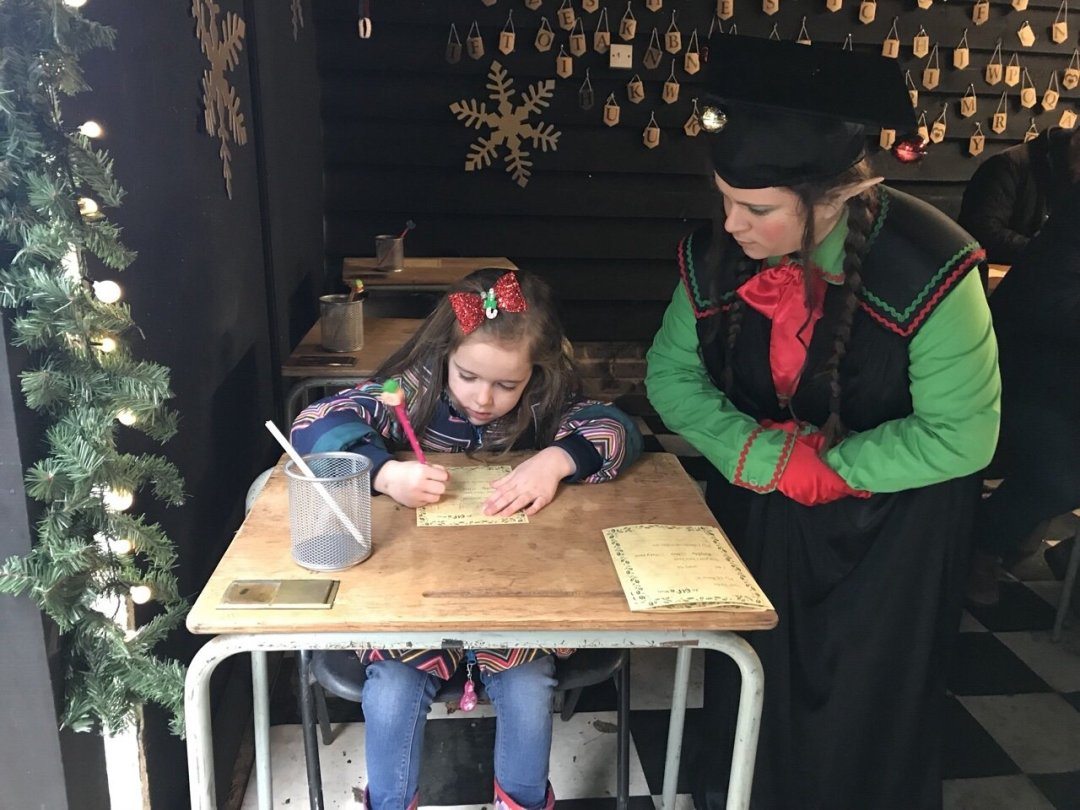 Eden writing her christmas wishes An Elf's Wish at Nevendon Manor