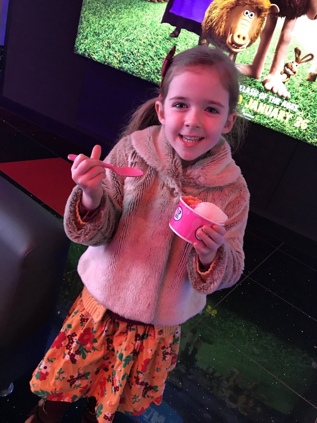 Eden with her ice cream at the cinema