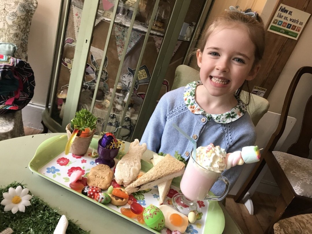 Eden enjoying her children's platter - A Tale of Peter rabbit themed afternoon tea
