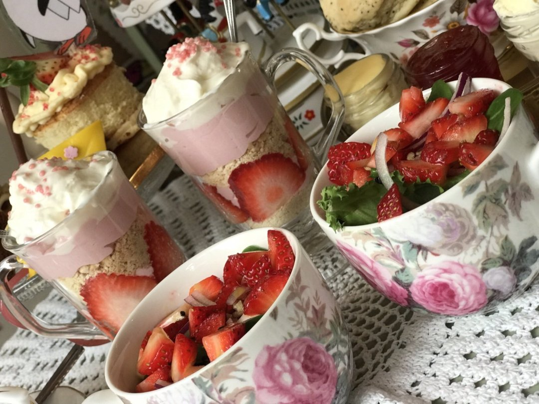 Mary Poppins Themed Afternoon Tea close up of salad in teacups with strawberries