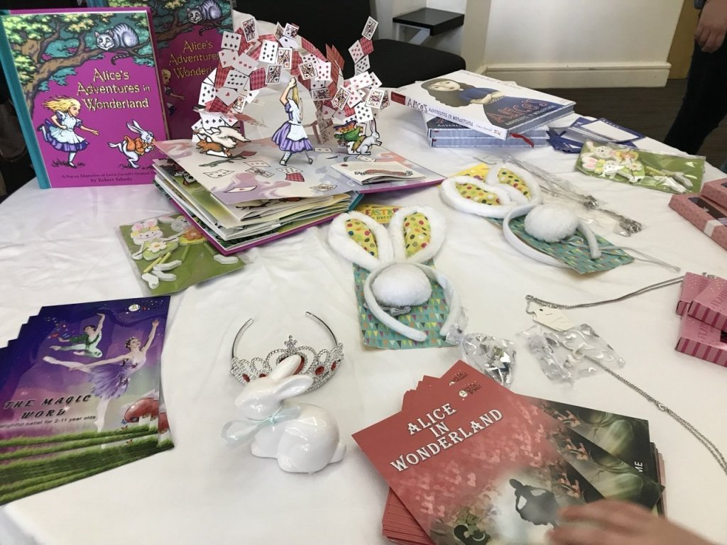 Alice in wonderland ballet stall with programs for sale