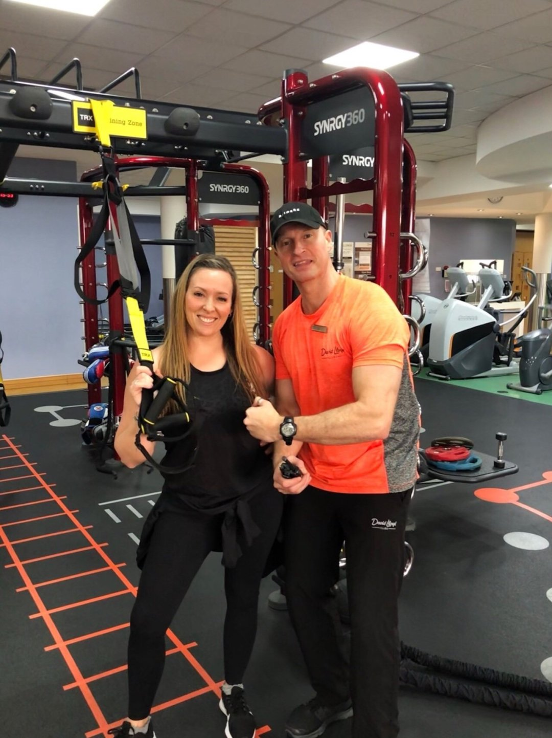 Personal Trainer and woman standing in the gym, gym motivation