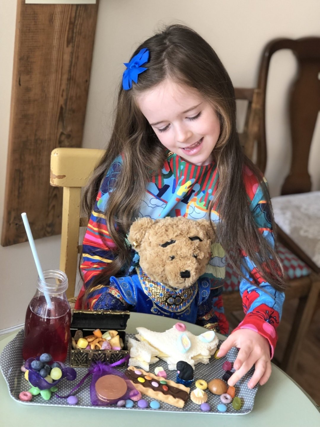 Little girl and bear with children's Aladdin themed afternoon tea