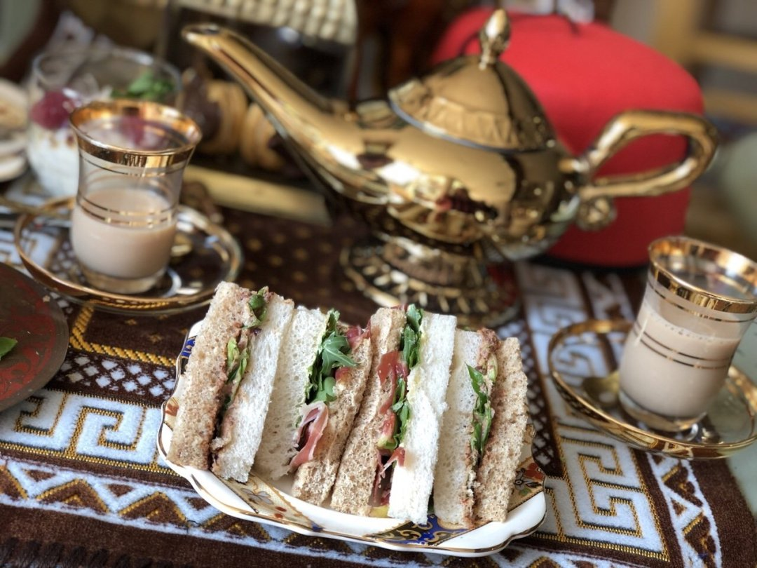 Sandwiches on a plate and lamp from Aladdin themed afternoon tea