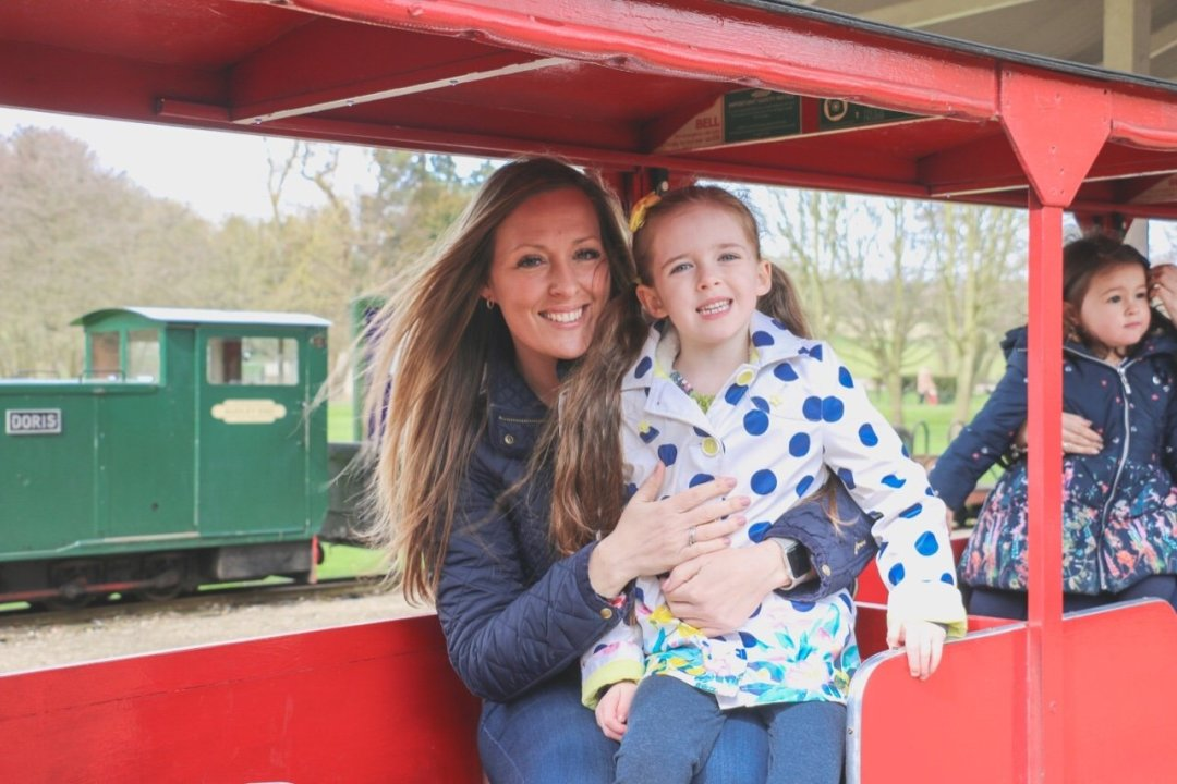 Easter Train at Audley End - Emma and Eden Essex blogger seated on a train