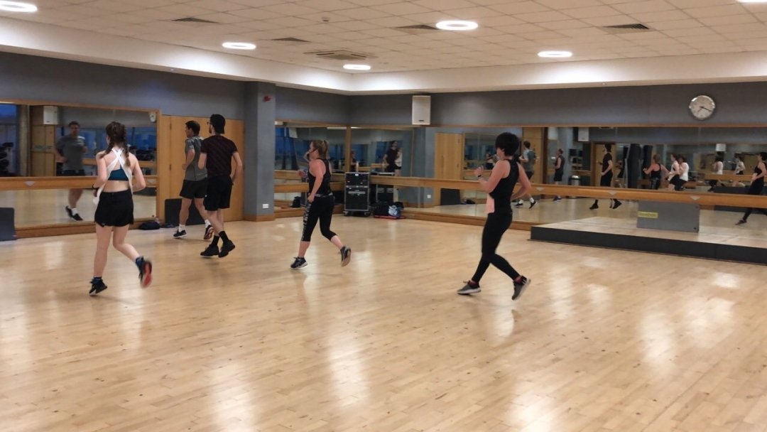 People running during group exercise les mills BodyAttack
