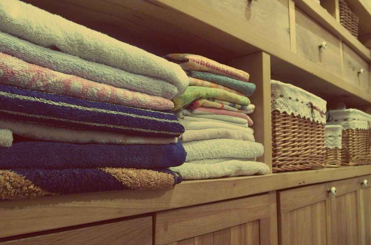 June challenge accountability time! photo of folded towels and baskets on a shelf