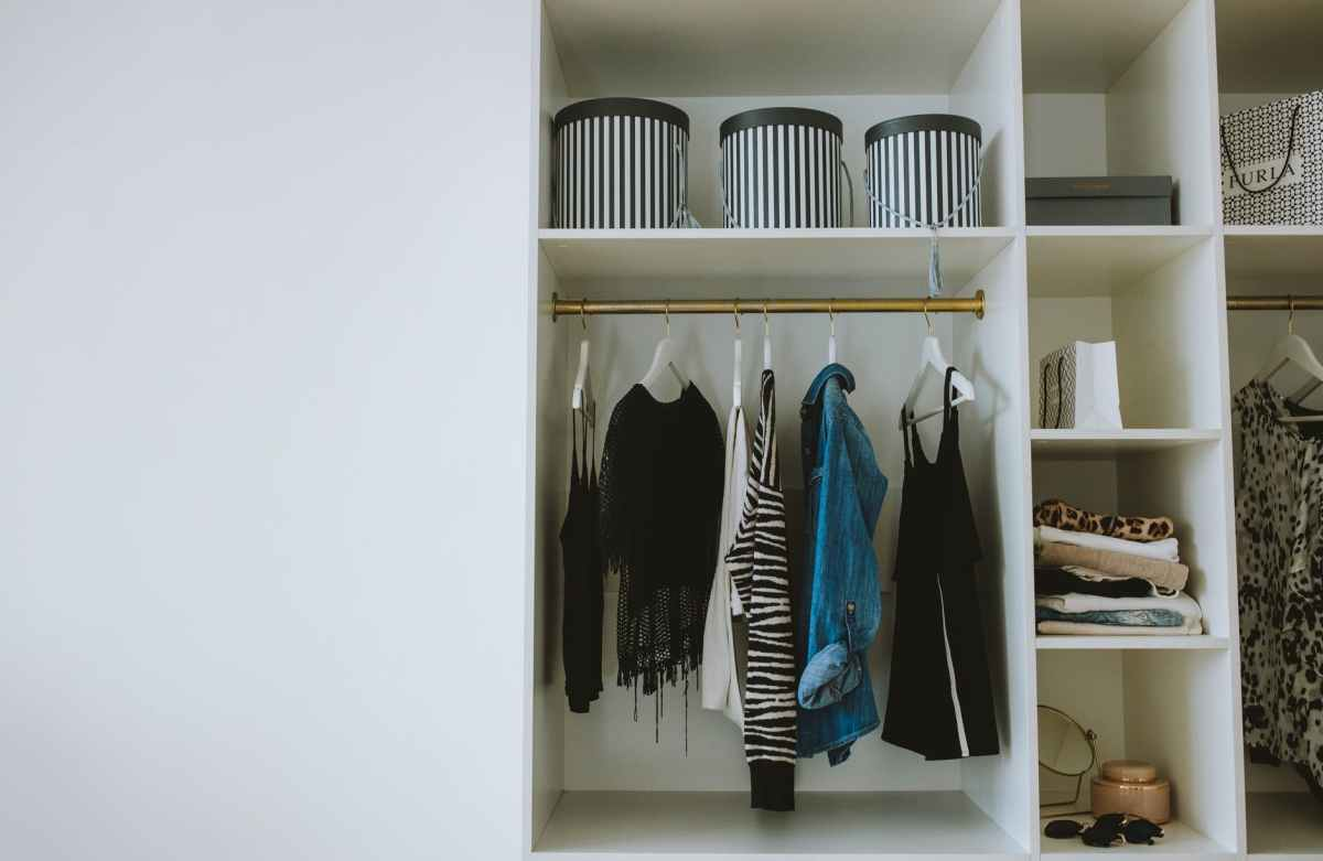 Declutter Challenge Top Tips showing photo of various shelves in a wardrobe with caption that reads: Rather than your whole wardrobe, pick one drawer or one shelf to declutter.