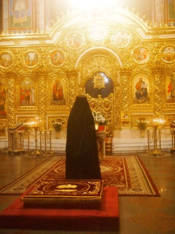 Orthodox Priest Paying
