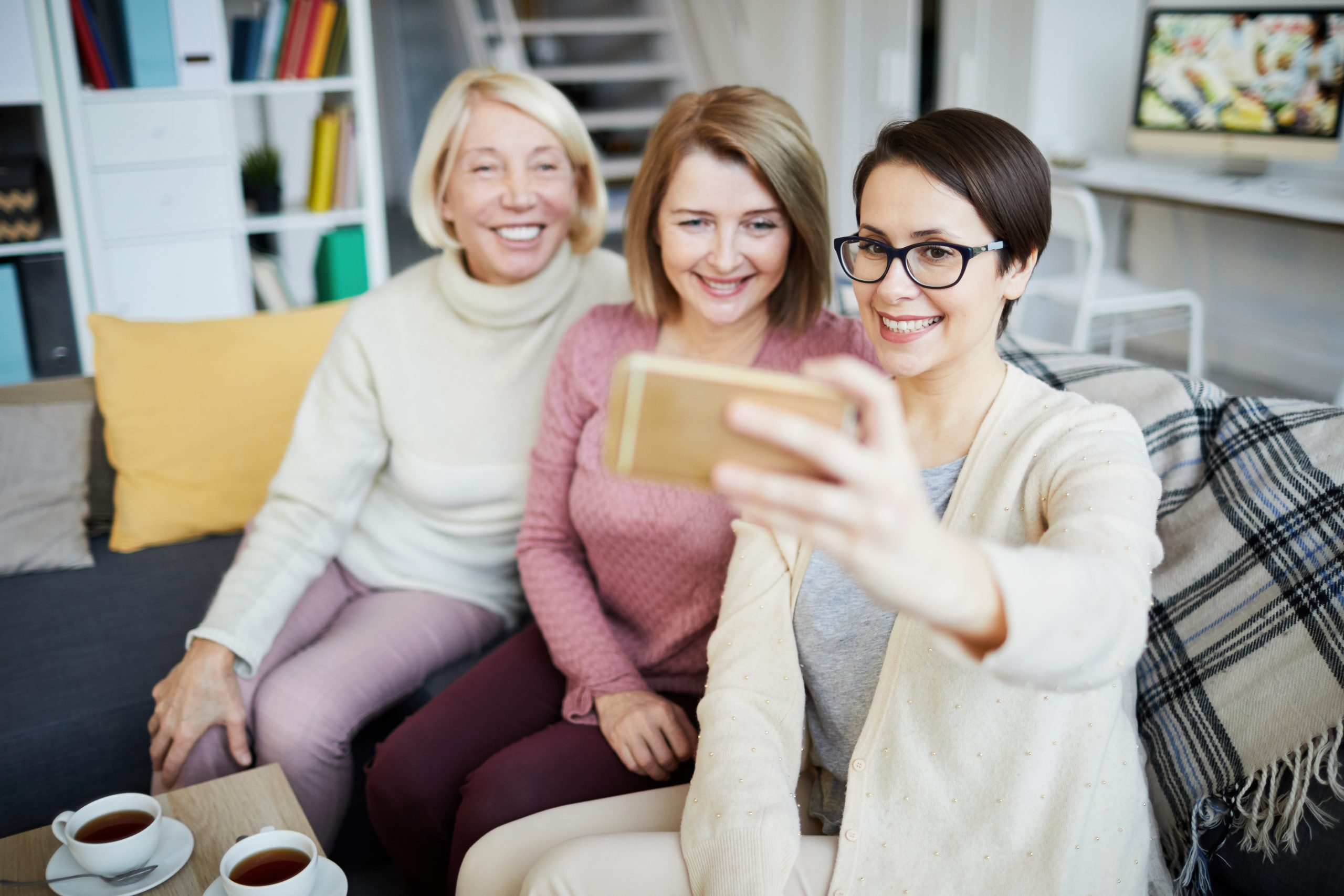 Women shoot smartphone video at home