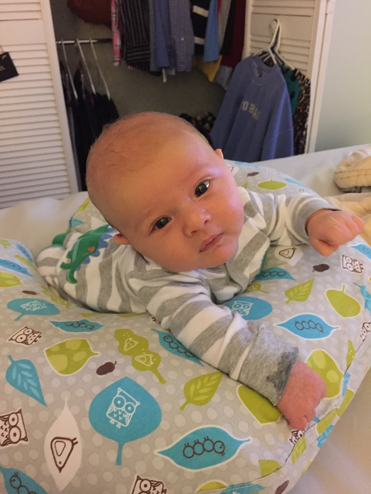 baby using boppy for tummy time