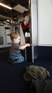 travel with toddlers-layover-flight delay-lap toddler-ittikid
