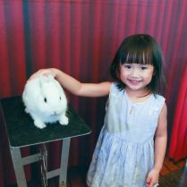 kid-with-magician-rabbit