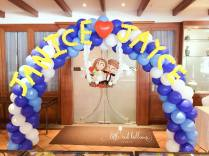wedding couple balloon arch