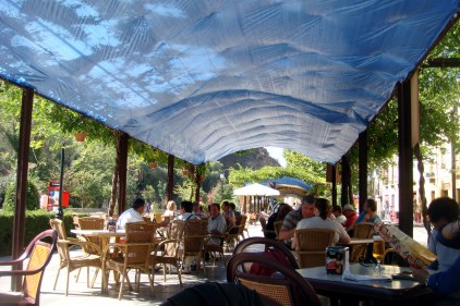 Outdoor restaurant seating area along the Albayzín district.