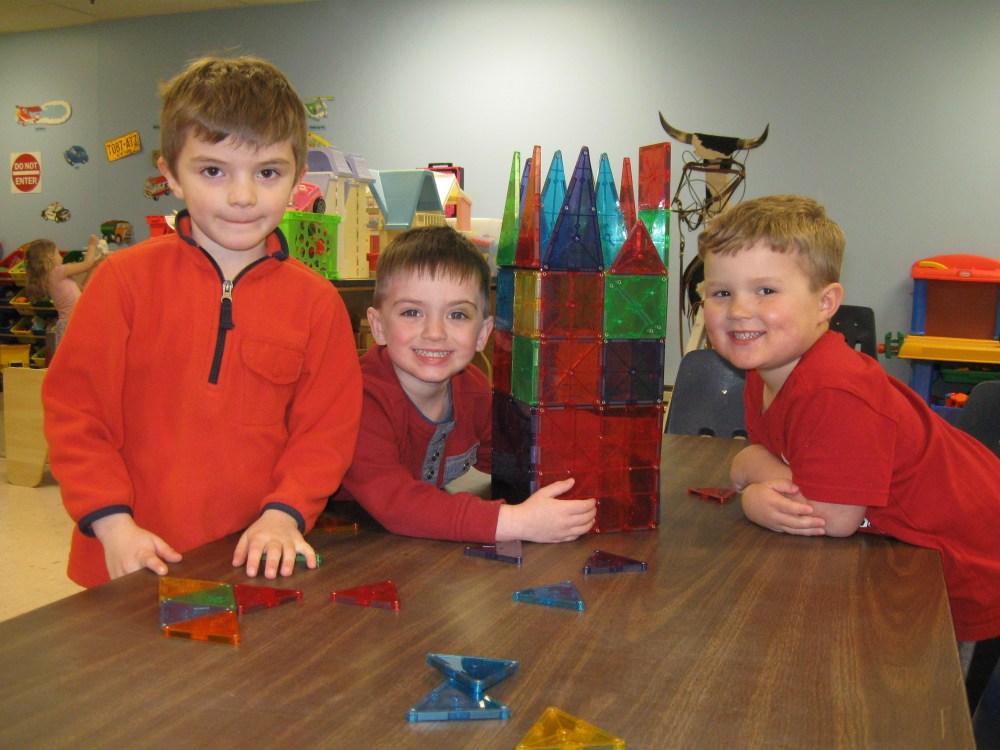 preschool boys playing with blocks