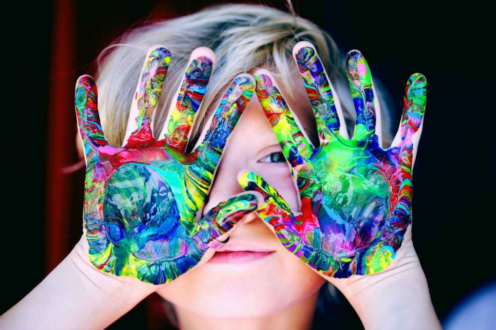 little kids with colored paint hands