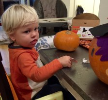 Asher trying to decorate a pumpkin