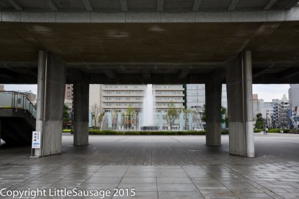 View underneath the Peace Memorial Museum to the Peace Fountains.