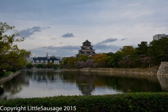 Some of modern Hiroshima peeks out behind the castle.
