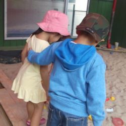 friends sand play child hug love nice care