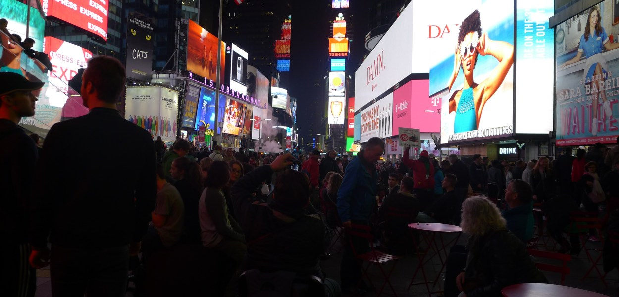 Times Quare with a row of buildings: Food in New York post
