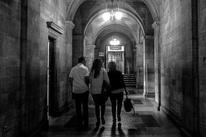 A group of students walking down a corridor at Bangor University: Feature post for— Choosing a University