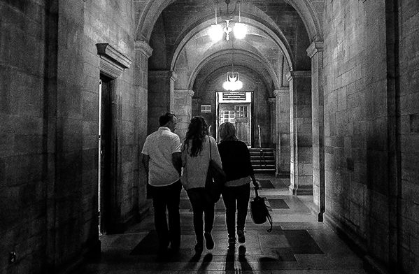 A group of students walking down a corridor at Bangor University: Feature post for— Choosing a University, my experience