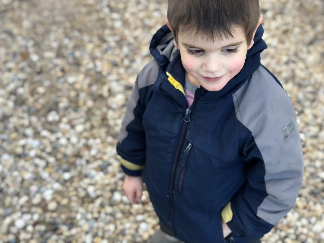 Little boy with a promise rock in his pocket
