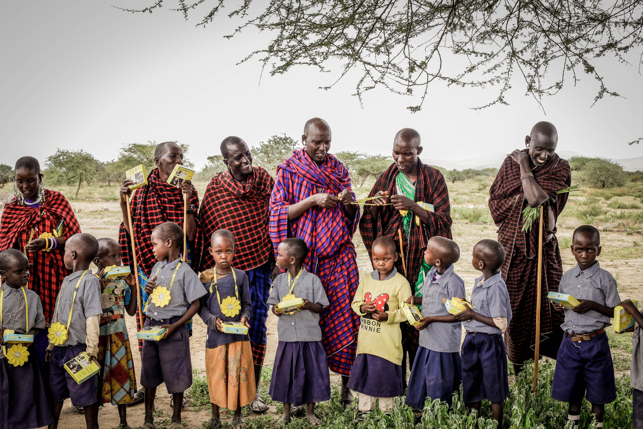 Massai community of women and kids with Little Sun solar lamps