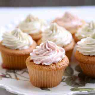 Jam filled cupcakes frosted with silky vanilla frosting