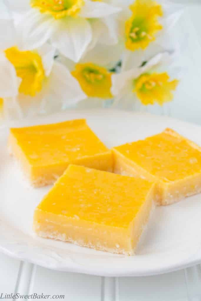 These heavenly tropical bars are made up of a tender crumbly coconut shortbread crust and topped with a fruity pineapple mango custard.