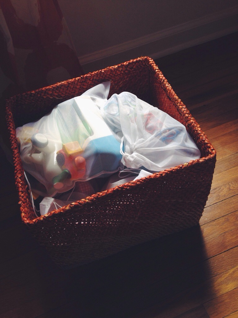 mesh produce bags in a larger bin for toy storage and organization