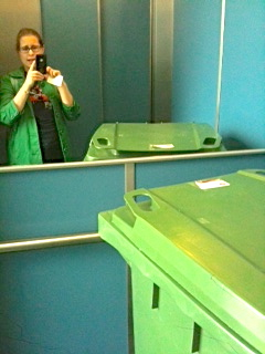 There was a waste bin in the lift at the museum.