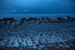 Lakeshore and snow at dusk, Lake Qinghai