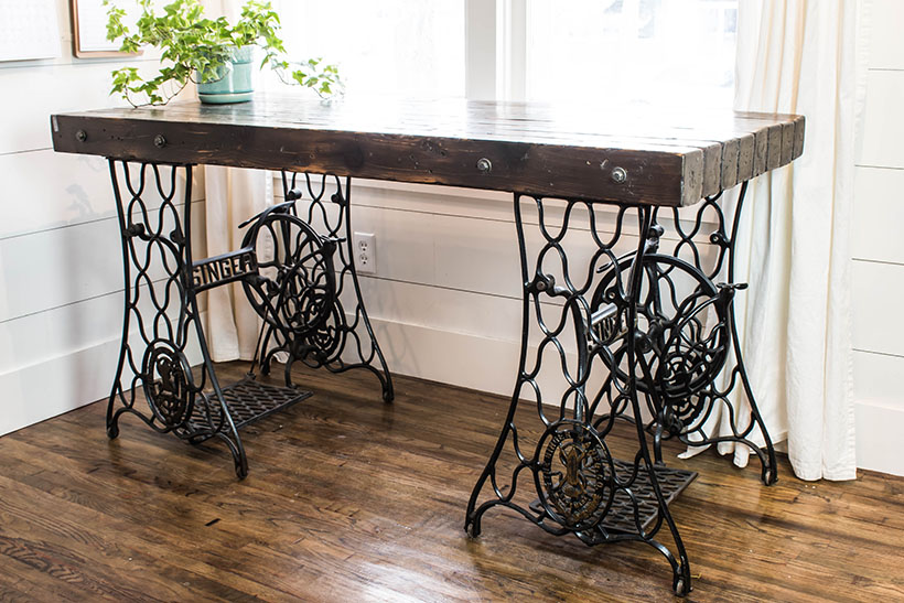 An Industrial desk made from two antique singer sewing machine treadle  bases. - Industrial Desk Made From Antique Singer Sewing Machine Treadle Bases.