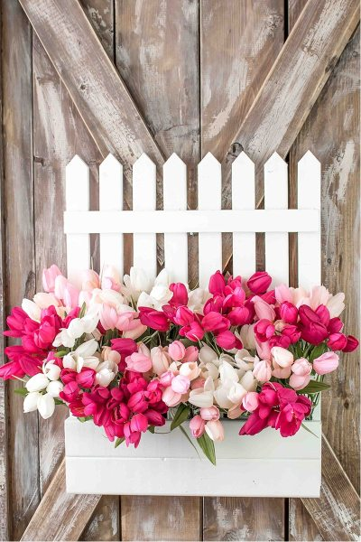 A Fun Spring Wreath with a White Picket Fence