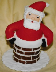 Santa stuck in a chimney cake