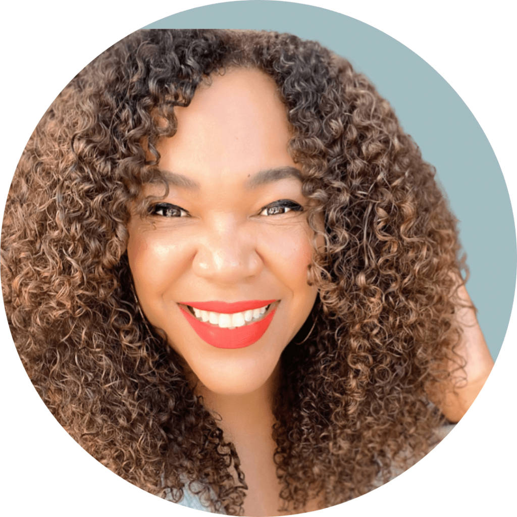 Black woman smiling with curly hair