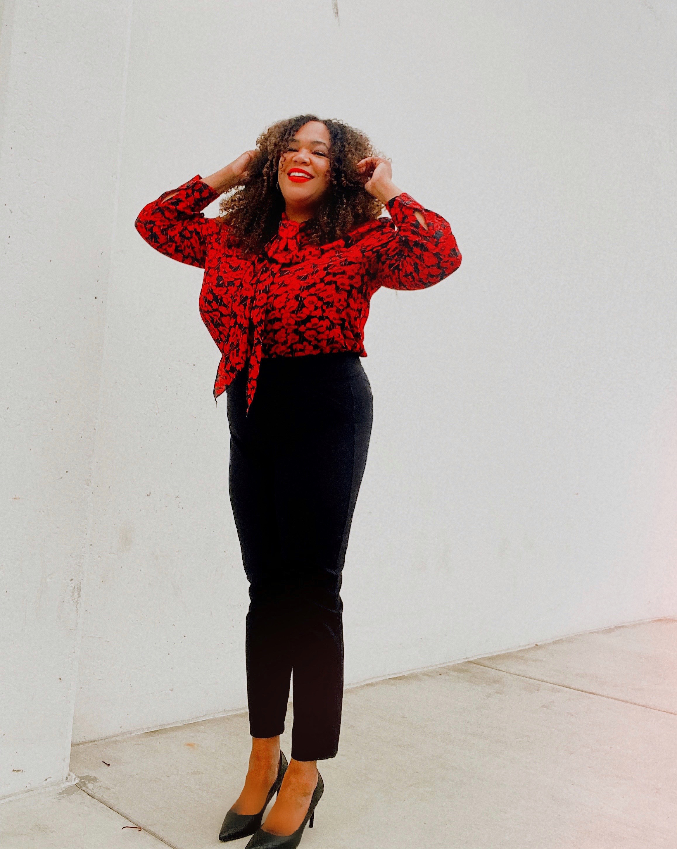 Black woman with black pants