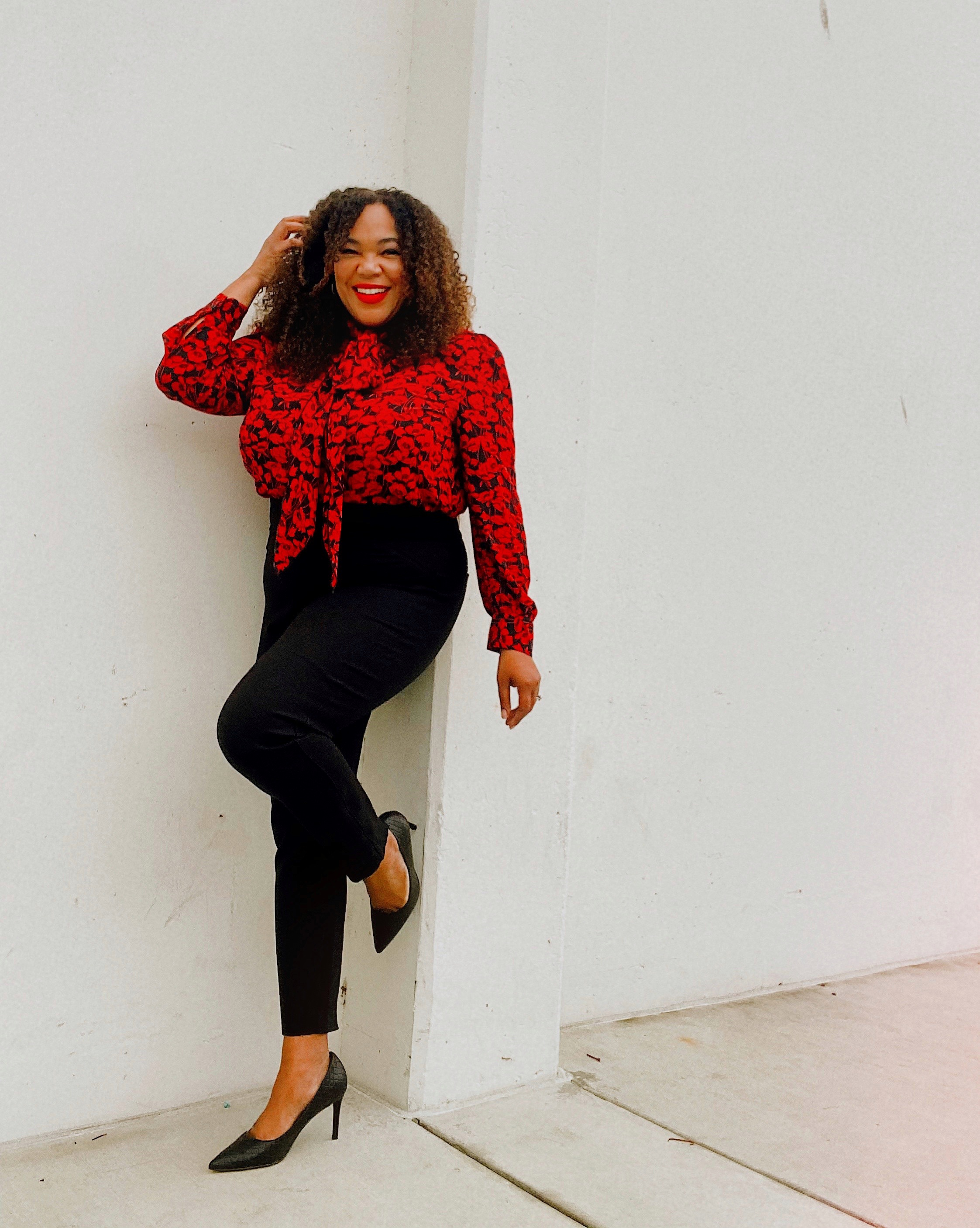 A black woman in black pants