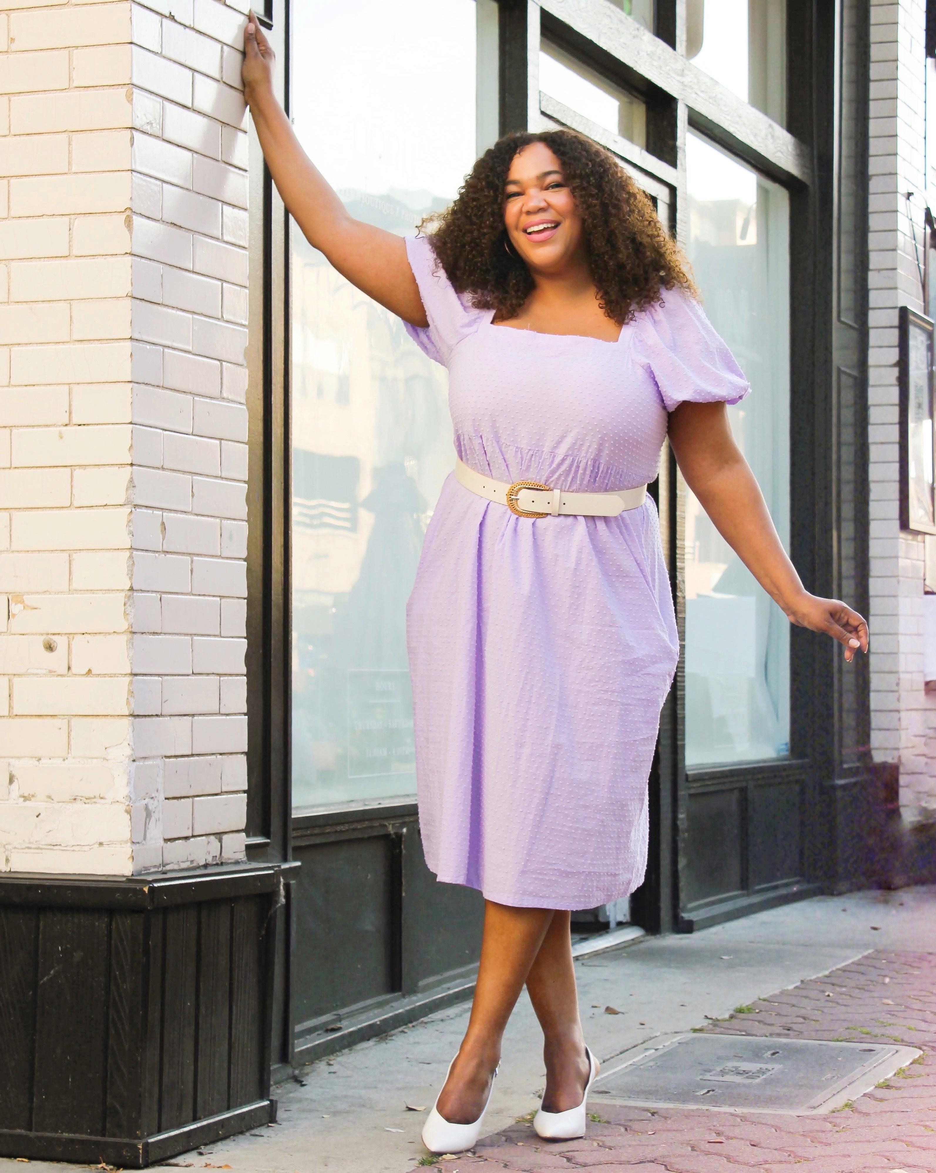 Black woman in a purple dress