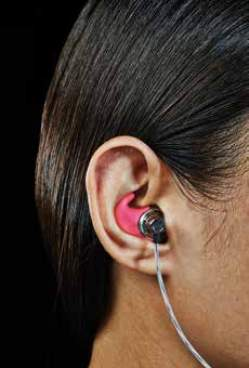 Images of three different people with customized ear buds in their ears