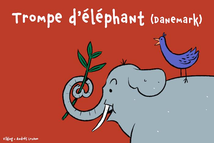 Un éléphant ramasse une branche, sa trompe formant une arobase