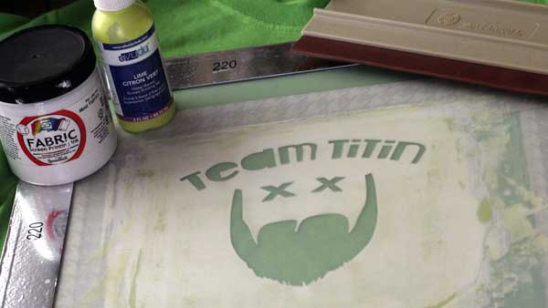 Some items you will need need to make a Custom Screen Printed T-shirt are a squeegee, a screen, stencil, fabric paint