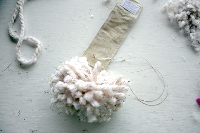 attaching the pompom to the Bunny Tail Napkin Ring