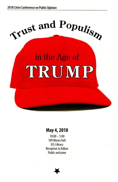 """2018 Citrin Conference Graphic - Red Hat with """"in the Age of Trump"""" written on it"""