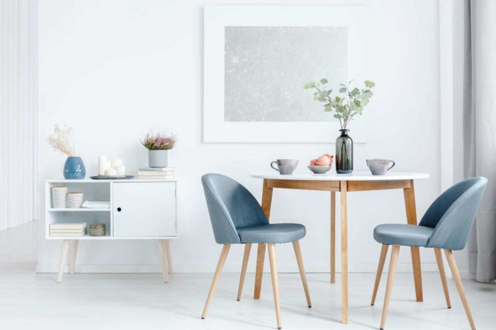 Small dining room with light colors and blue for contrast